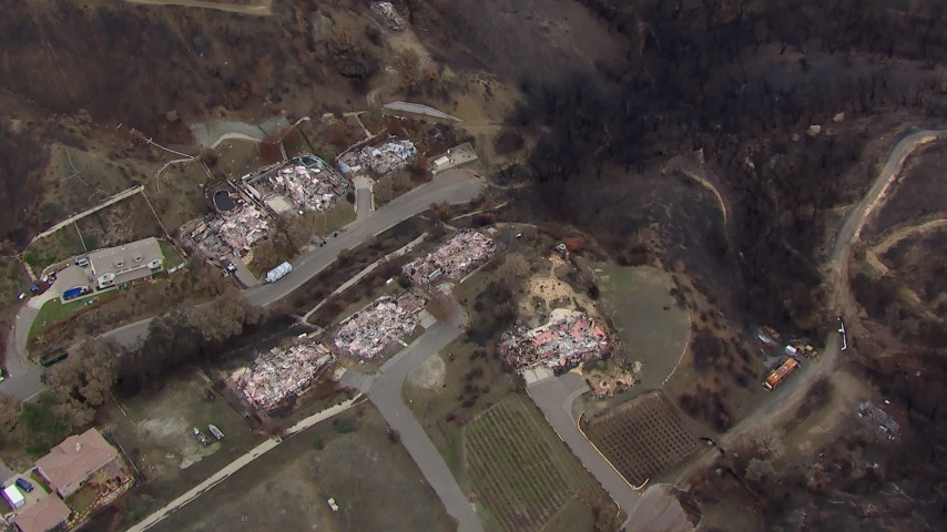 HD stock footage aerial video of a bird's eye view of homes destroyed by fire, Malibu, California Aerial Stock Footage | CAP_018_021