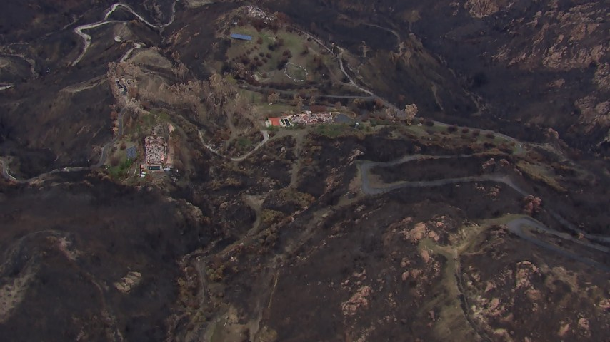 HD stock footage aerial video of approaching hillside homes destroyed by fire, Malibu, California Aerial Stock Footage | CAP_018_022