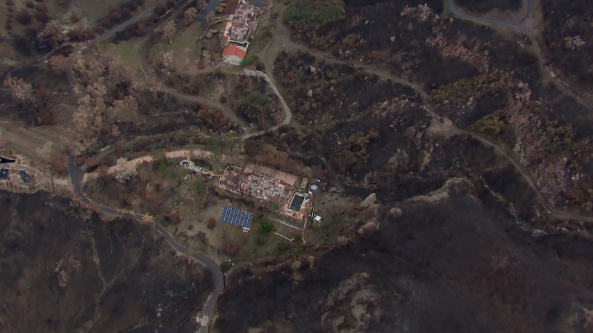 HD stock footage aerial video of a bird's eye view of hillside homes destroyed by fire, Malibu, California Aerial Stock Footage | CAP_018_023