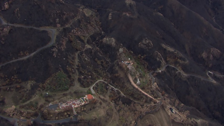 HD stock footage aerial video fly away from and orbit hillside homes destroyed by fire, Malibu, California Aerial Stock Footage | CAP_018_025