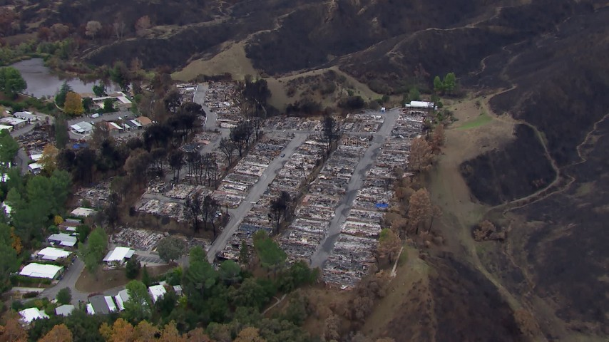 HD stock footage aerial video of orbiting a neighborhood destroyed by fire, Malibu, California Aerial Stock Footage | CAP_018_030