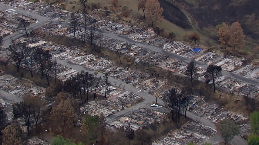 HD stock footage aerial video of circling a neighborhood destroyed by fire, Malibu, California Aerial Stock Footage | CAP_018_031