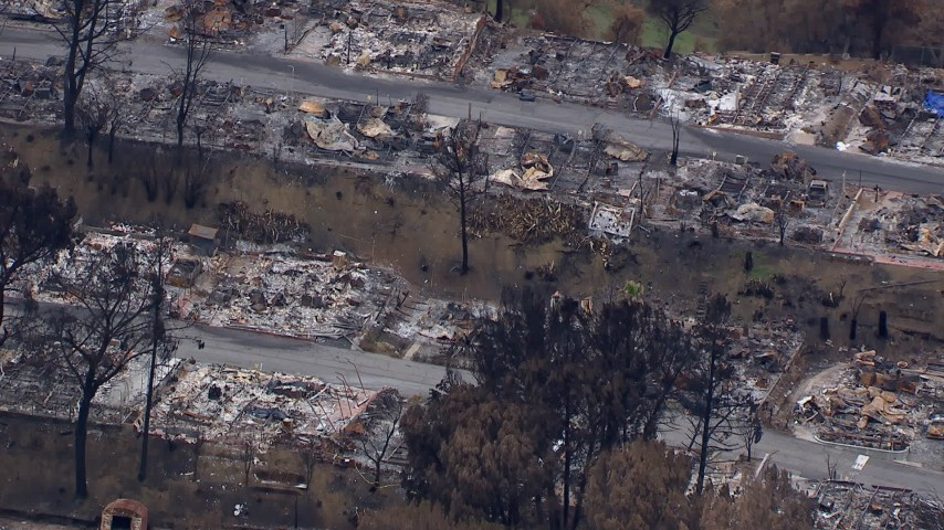 HD stock footage aerial video of a close-up view of a neighborhood destroyed by fire, Malibu, California Aerial Stock Footage | CAP_018_032