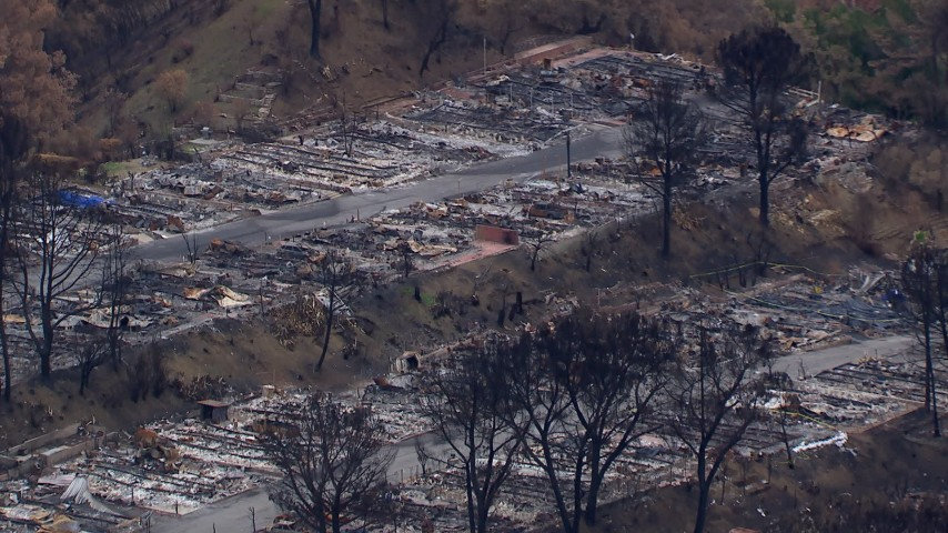 HD stock footage aerial video of a reverse view of a neighborhood devastated by fire, Malibu, California Aerial Stock Footage | CAP_018_035
