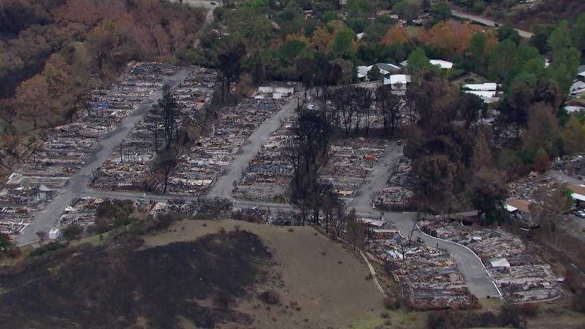 HD stock footage aerial video of flying away from a neighborhood devastated by fire, Malibu, California Aerial Stock Footage | CAP_018_036