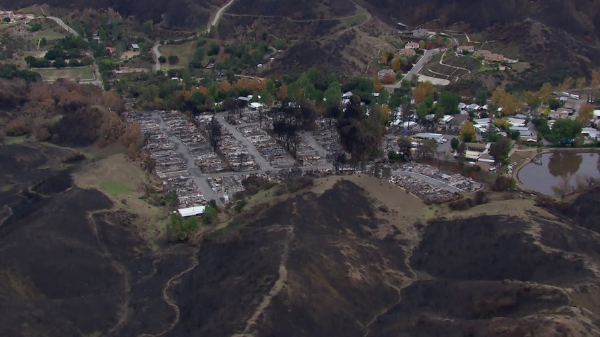 HD stock footage aerial video of flying away from ruins in a neighborhood devastated by fire, Malibu, California Aerial Stock Footage | CAP_018_037