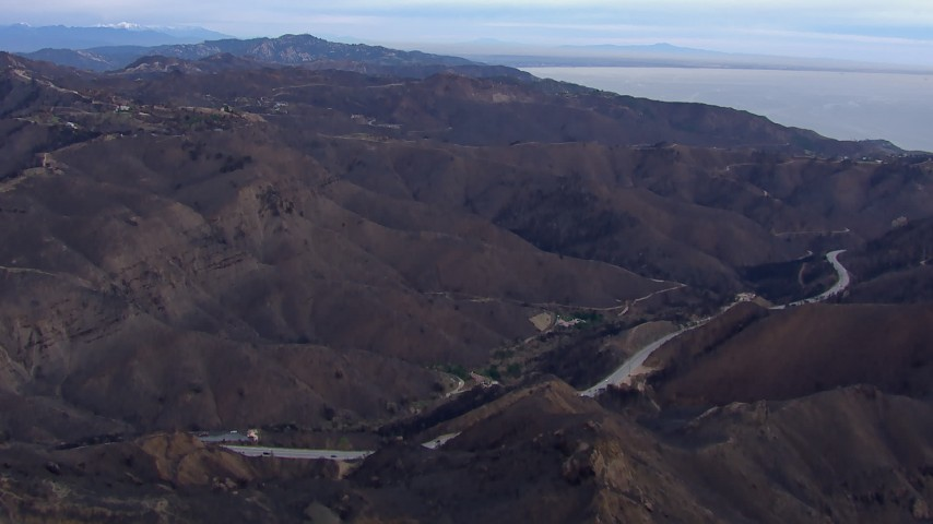 HD stock footage aerial video of mountains scorched by fire, Malibu, California Aerial Stock Footage | CAP_018_041
