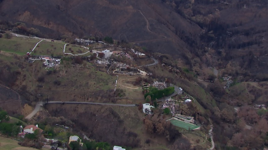 HD stock footage aerial video of flying toward homes destroyed by fire, Malibu, California Aerial Stock Footage | CAP_018_044