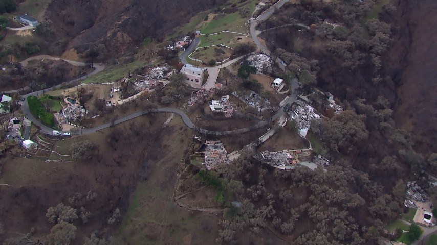 HD stock footage aerial video orbit and fly away from homes destroyed by fire, Malibu, California Aerial Stock Footage | CAP_018_047