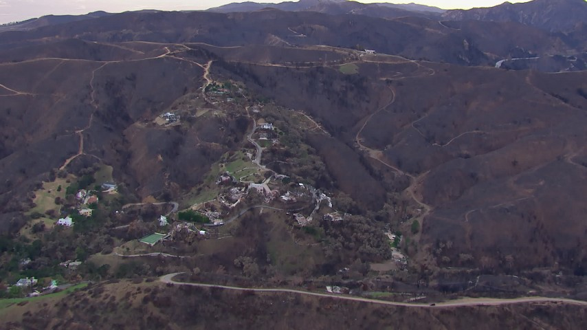 HD stock footage aerial video of a reverse view of homes destroyed by fire, Malibu, California Aerial Stock Footage | CAP_018_048