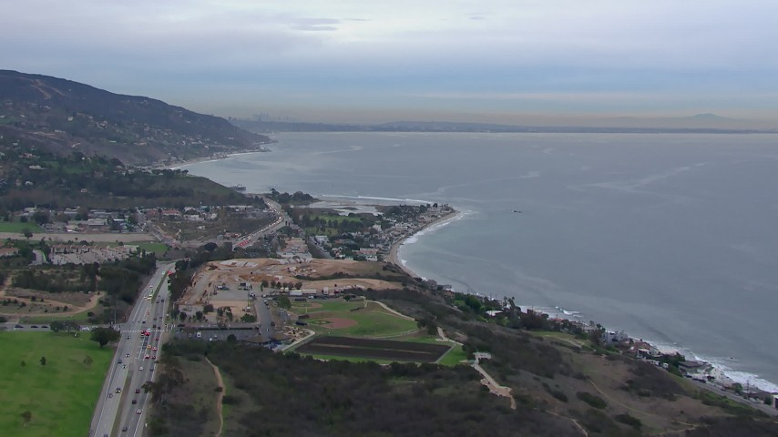 HD stock footage aerial video of flying toward oceanfront homes in Malibu at sunset, California Aerial Stock Footage | CAP_018_050