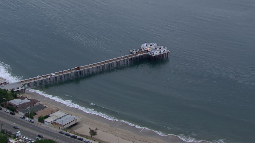 HD stock footage aerial video of approaching and orbiting Malibu Pier at sunset, California Aerial Stock Footage | CAP_018_053