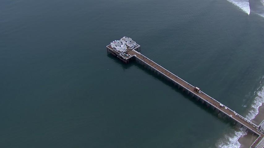 HD stock footage aerial video of orbiting Malibu Pier at sunset, California Aerial Stock Footage | CAP_018_054