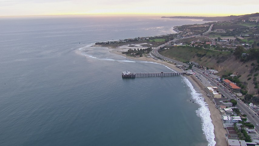 HD stock footage aerial video of flying away from Malibu Pier at sunset, California Aerial Stock Footage | CAP_018_055