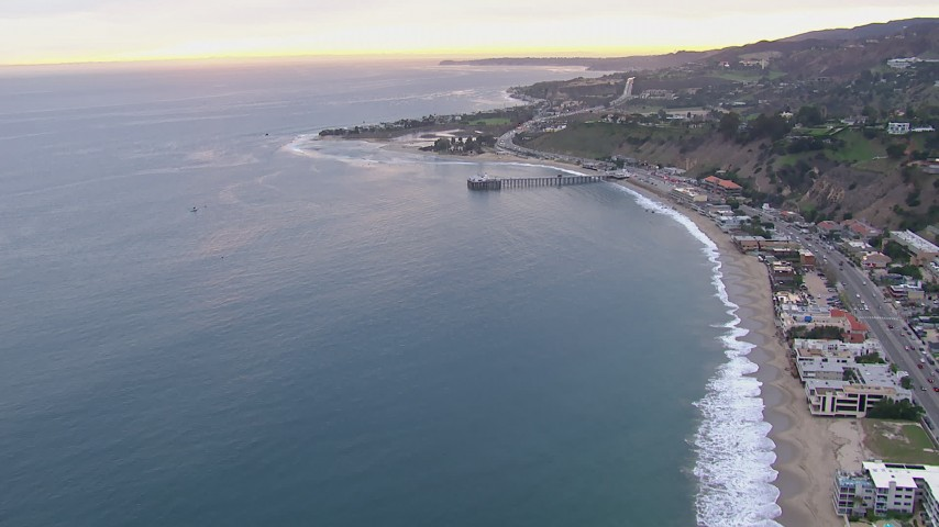HD stock footage aerial video of flying away from neighborhoods and Malibu Pier at sunset, California Aerial Stock Footage | CAP_018_056