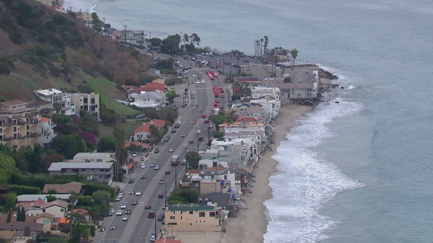 HD stock footage aerial video of beachfront homes by PCH at sunset, California Aerial Stock Footage | CAP_018_057