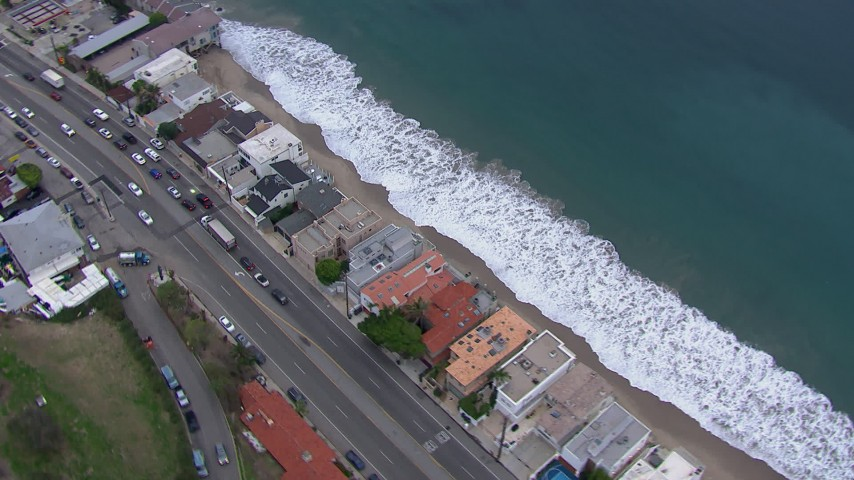 HD stock footage aerial video of tilting to a bird's eye view of beachfront homes by PCH at sunset, California Aerial Stock Footage | CAP_018_058