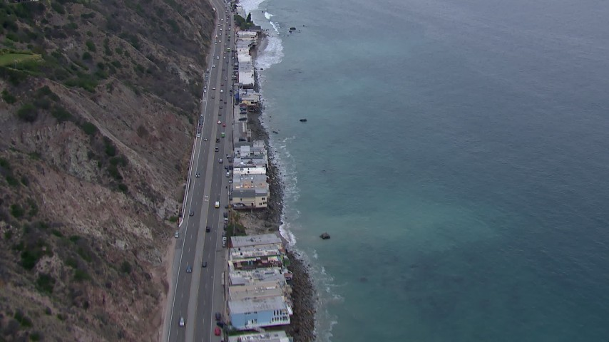 HD stock footage aerial video of oceanfront homes by PCH at sunset, Malibu, California Aerial Stock Footage | CAP_018_059