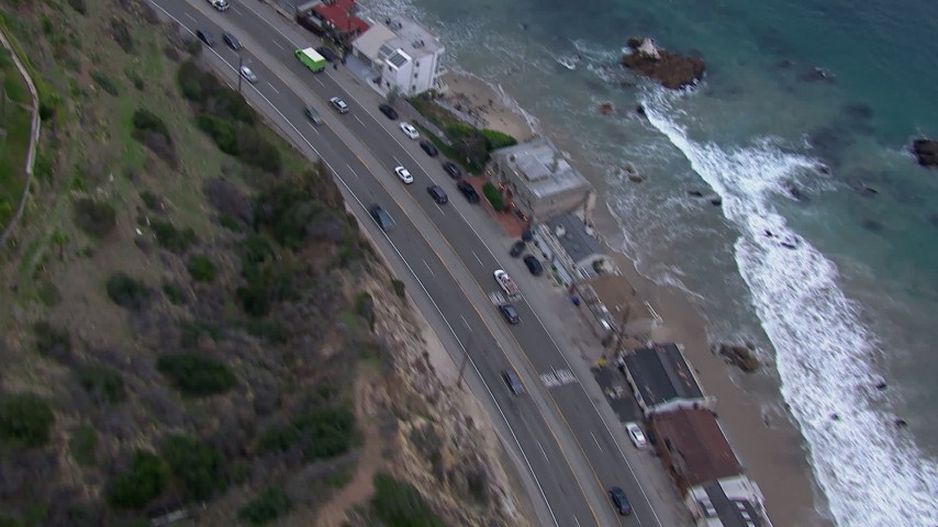 HD stock footage aerial video of light traffic on PCH at sunset and Malibu homes, California Aerial Stock Footage | CAP_018_061