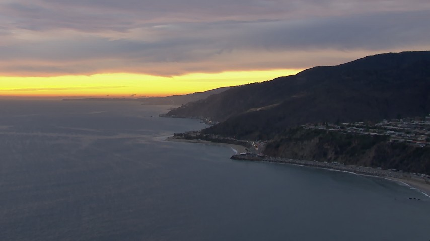 HD stock footage aerial video of a reverse view of Malibu at sunset, California Aerial Stock Footage | CAP_018_062
