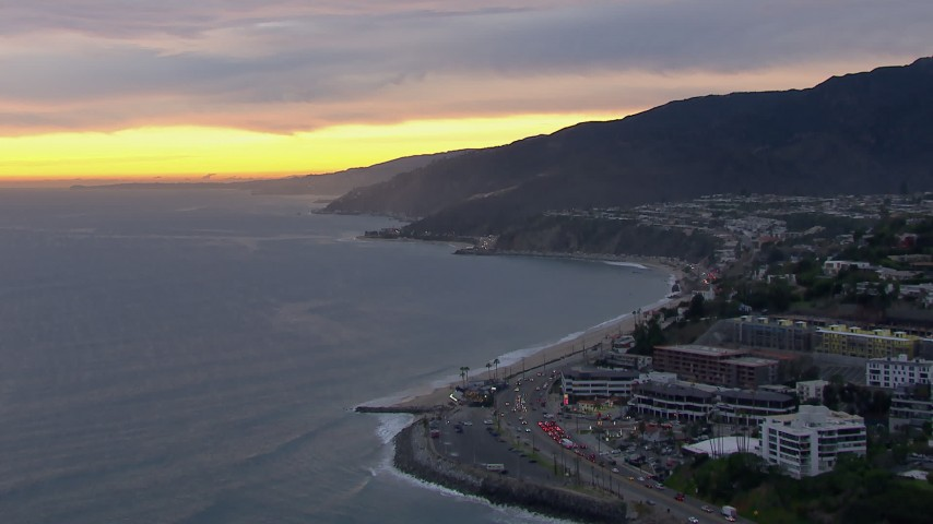 HD stock footage aerial video of a wide reverse view of Malibu at sunset, California Aerial Stock Footage | CAP_018_063