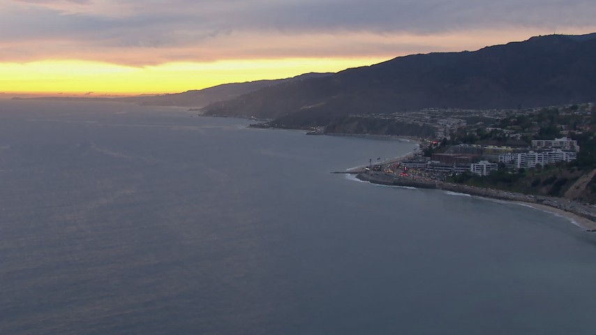 HD stock footage aerial video of flying away from Malibu at sunset, California Aerial Stock Footage | CAP_018_064