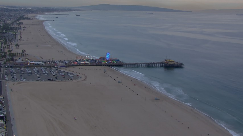HD stock footage aerial video of flying over the beach toward Santa Monica Pier at sunset, California Aerial Stock Footage | CAP_018_065
