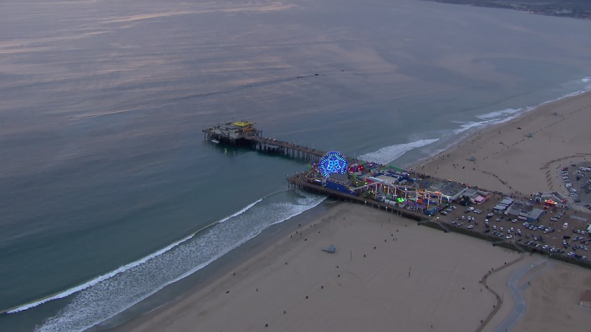 HD stock footage aerial video of an orbit of Santa Monica Pier at sunset, California Aerial Stock Footage | CAP_018_067