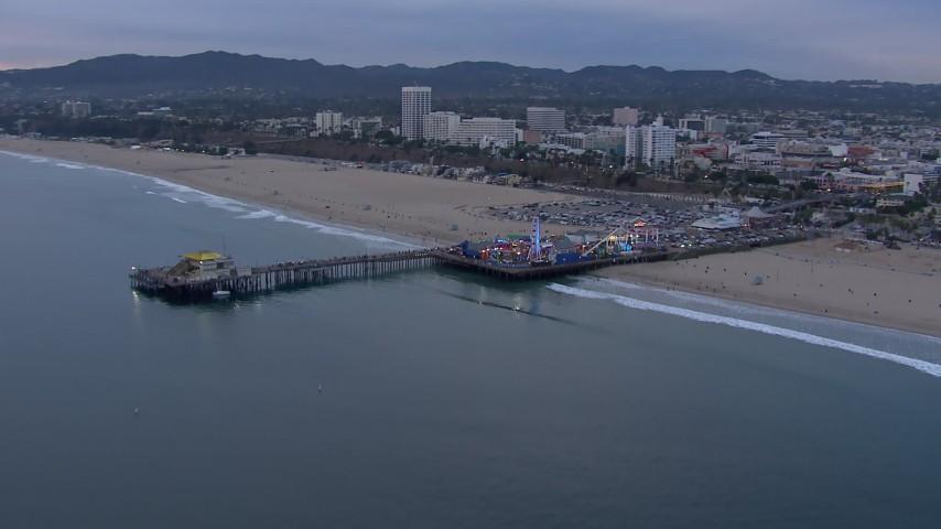 HD stock footage aerial video orbit Santa Monica Pier and Ferris wheel at sunset, California Aerial Stock Footage | CAP_018_068