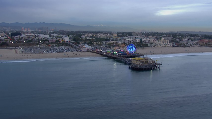 HD stock footage aerial video orbit the end of Santa Monica Pier and Ferris wheel at sunset, California Aerial Stock Footage | CAP_018_069