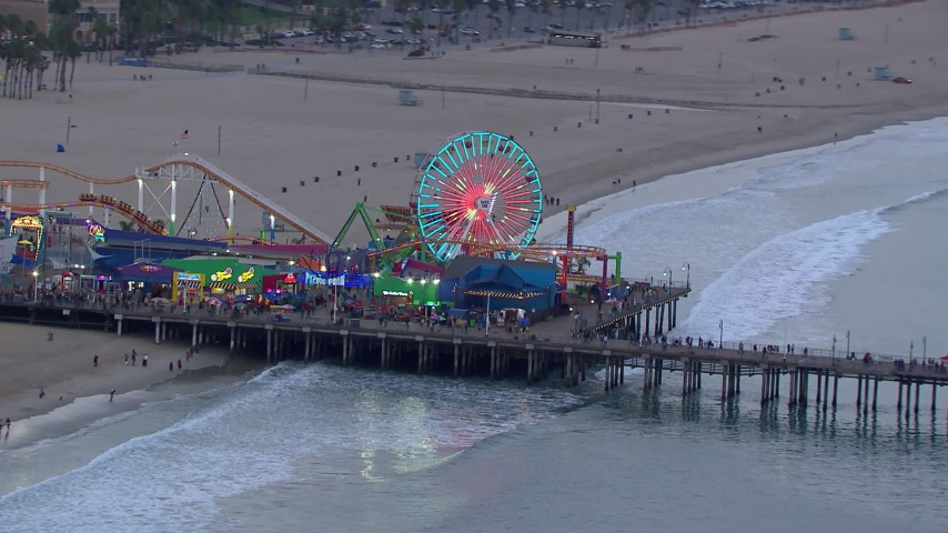 HD stock footage aerial video of the Ferris wheel at Santa Monica Pier at sunset, California Aerial Stock Footage | CAP_018_070