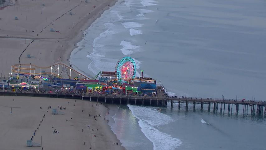 HD stock footage aerial video of orbiting the Ferris wheel at Santa Monica Pier at sunset, California Aerial Stock Footage | CAP_018_071