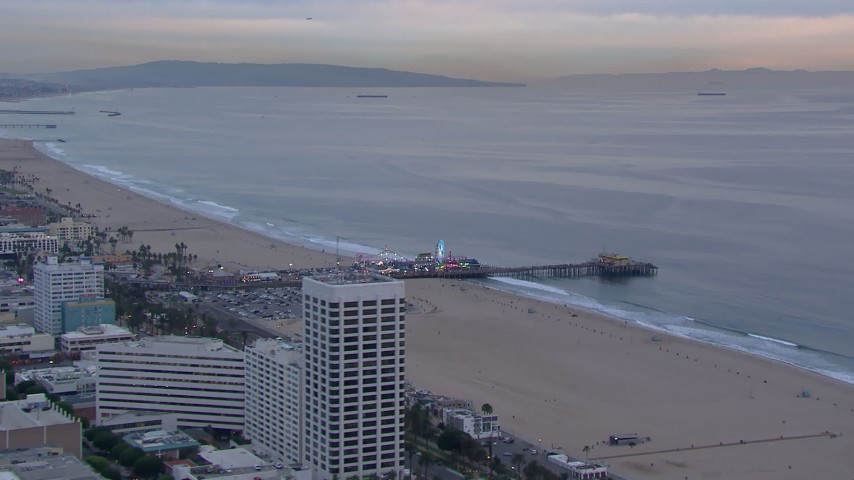 HD stock footage aerial video fly away from and orbit Santa Monica Pier at sunset, California Aerial Stock Footage | CAP_018_072