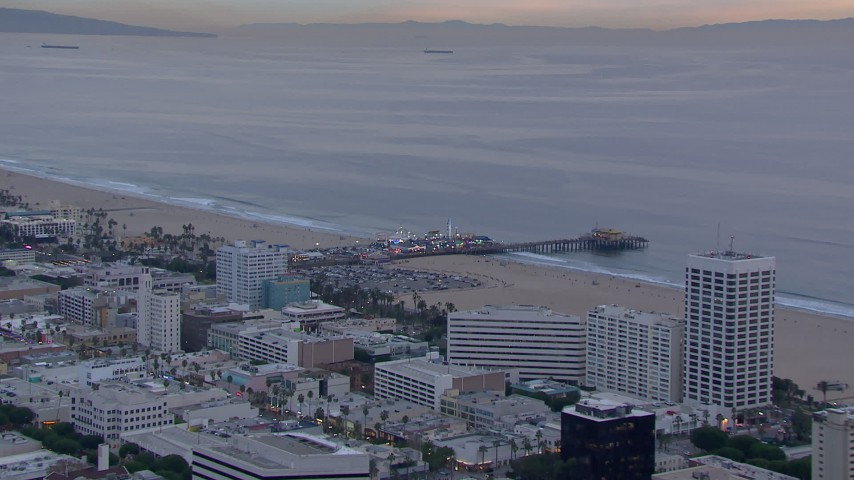 HD stock footage aerial video of a wider orbit of Santa Monica Pier at sunset, California Aerial Stock Footage | CAP_018_073