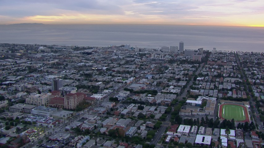 HD stock footage aerial video of a reverse view of Santa Monica and the ocean at sunset, California Aerial Stock Footage | CAP_018_074