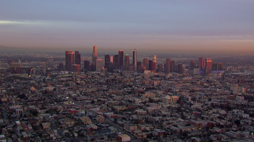 HD stock footage aerial video of a wide view of the Downtown Los Angeles skyline at sunset, California Aerial Stock Footage | CAP_018_087