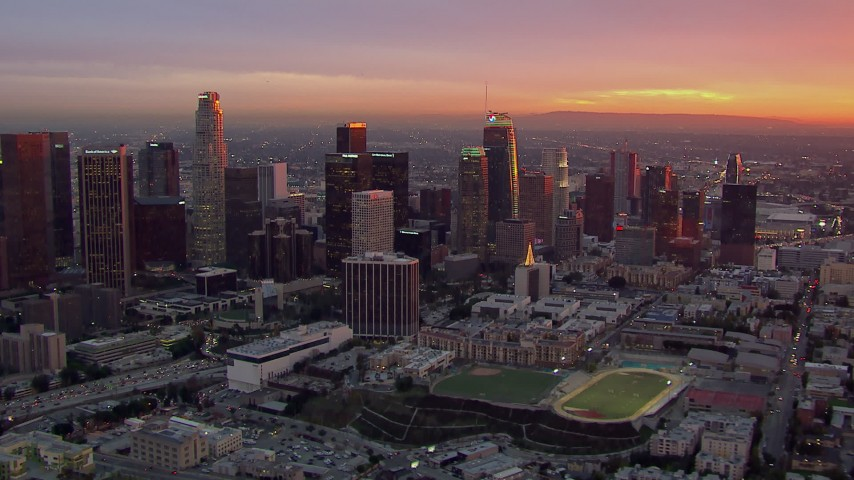 HD stock footage aerial video of passing by the Downtown Los Angeles skyline at sunset, California Aerial Stock Footage | CAP_018_090