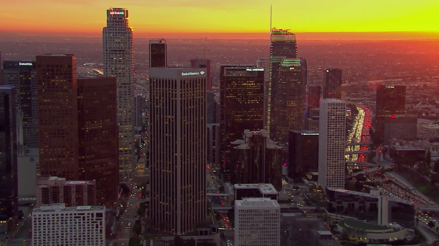 HD stock footage aerial video of passing by the Downtown Los Angeles skyscrapers at sunset, California Aerial Stock Footage | CAP_018_091