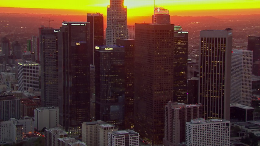 HD stock footage aerial video of flying by the Downtown Los Angeles skyscrapers at sunset, California Aerial Stock Footage | CAP_018_092