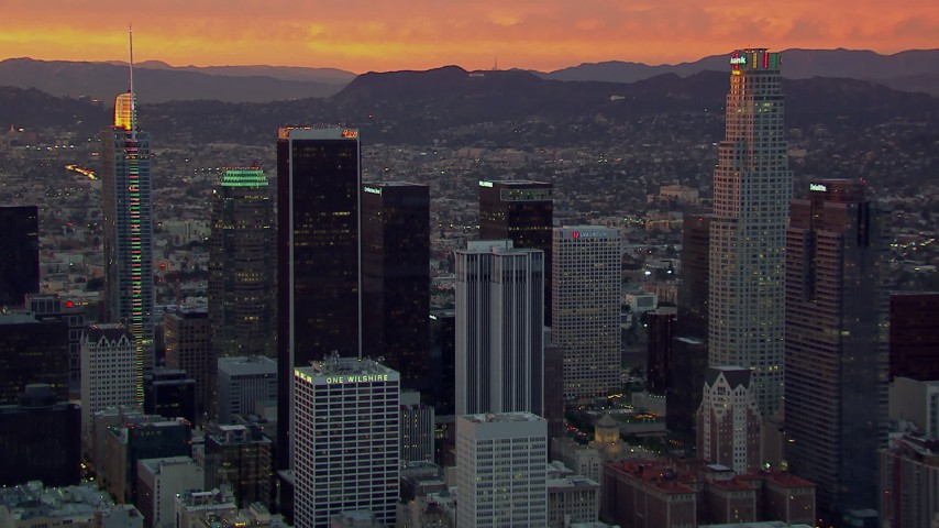 HD stock footage aerial video of flying by US Bank Tower and other Downtown Los Angeles skyscrapers at sunset, California Aerial Stock Footage | CAP_018_095