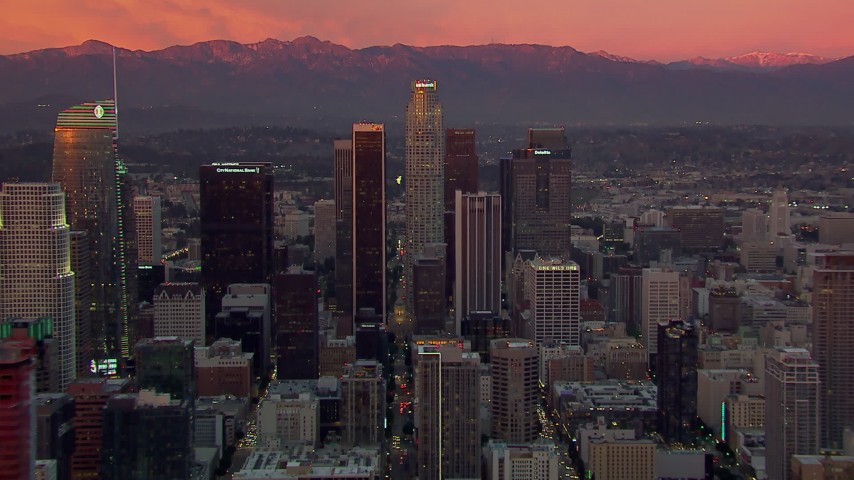 HD stock footage aerial video flying by towering Downtown Los Angeles skyscrapers at sunset, California Aerial Stock Footage | CAP_018_097