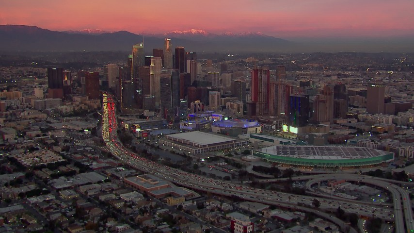 HD stock footage aerial video of Downtown Los Angeles skyscrapers, arena and convention center at sunset, California Aerial Stock Footage | CAP_018_099