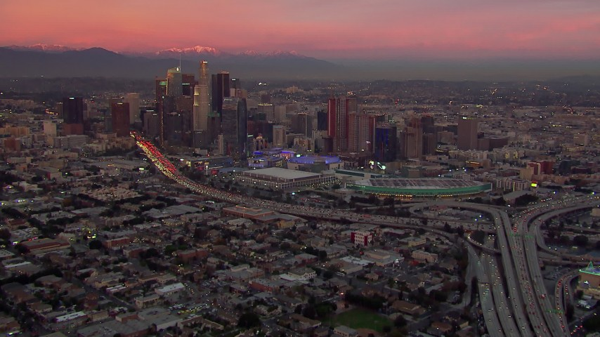 HD stock footage aerial video of flying away from Downtown Los Angeles skyscrapers at sunset, California Aerial Stock Footage | CAP_018_100
