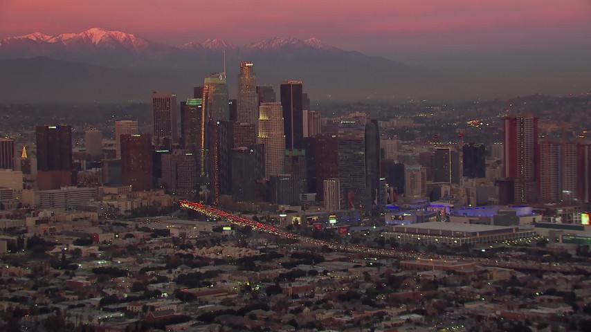 HD stock footage aerial video of flying by Downtown Los Angeles skyscrapers at sunset, California Aerial Stock Footage | CAP_018_101