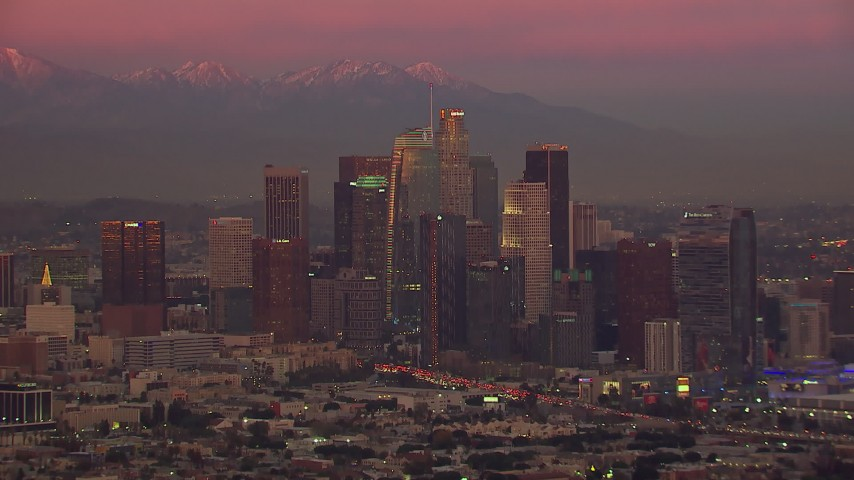 HD stock footage aerial video of slowly passing Downtown Los Angeles skyscrapers at sunset, California Aerial Stock Footage | CAP_018_102