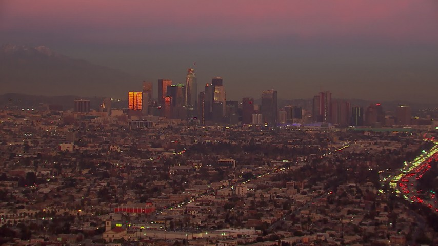 HD stock footage aerial video of a wide view of the Downtown Los Angeles skyline at sunset, California Aerial Stock Footage | CAP_018_104