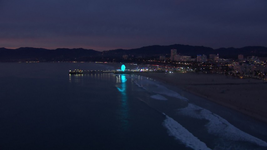 HD stock footage aerial video of slowly approaching Santa Monica Pier at twilight, California Aerial Stock Footage | CAP_018_106