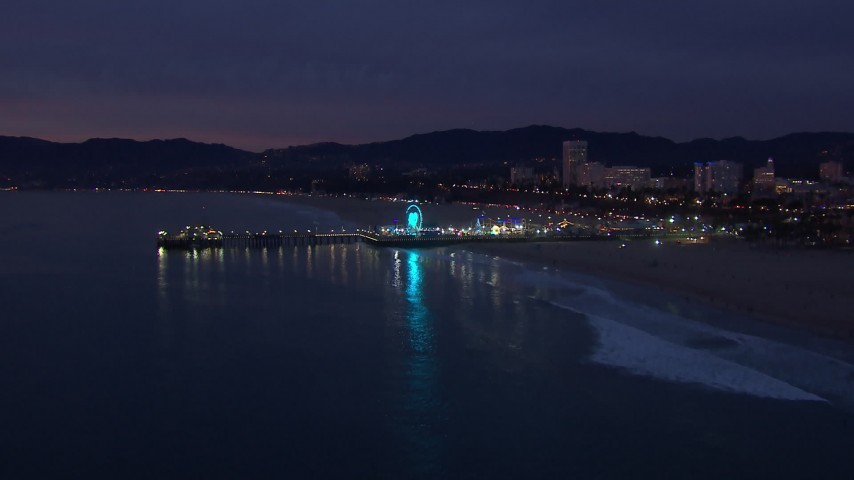 HD stock footage aerial video of approaching Santa Monica Pier and Ferris wheel at twilight, California Aerial Stock Footage | CAP_018_107