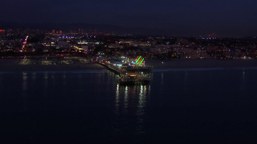 HD stock footage aerial video of flying toward Santa Monica Pier and Ferris wheel at twilight, California Aerial Stock Footage | CAP_018_109