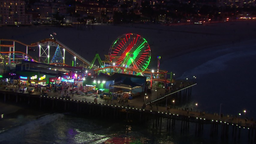 HD stock footage aerial video orbit and fly away from Ferris wheel at twilight, Santa Monica Pier, California Aerial Stock Footage | CAP_018_111